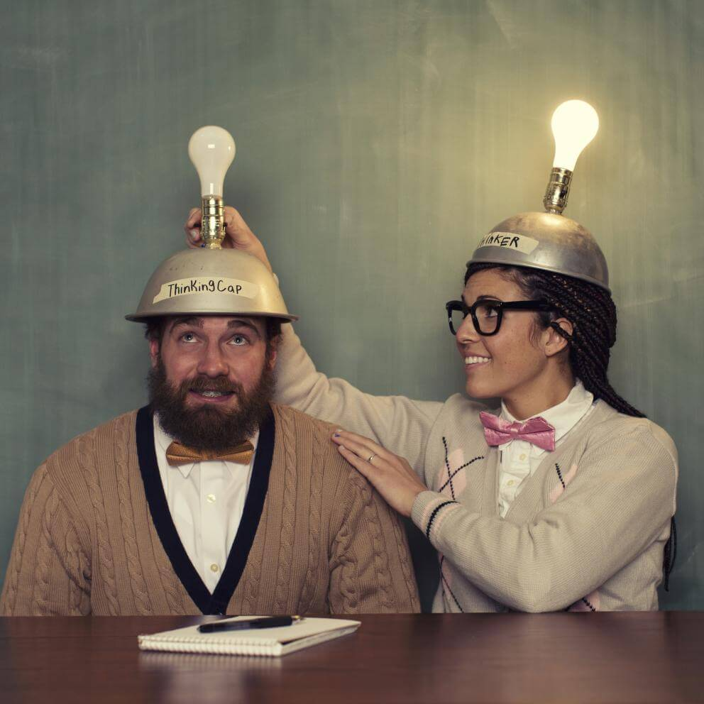 two people with hats with lightbulbs on top
