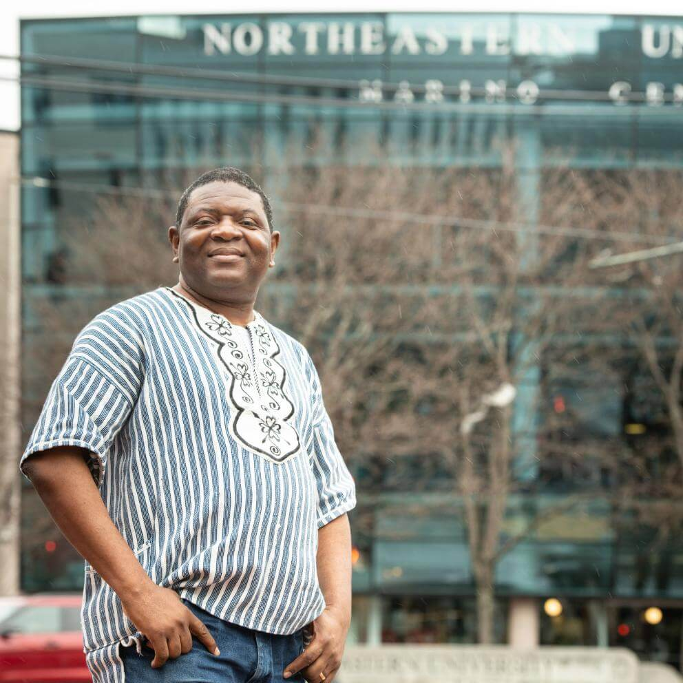 Alfred Brownell stands in front of a Northeastern University building