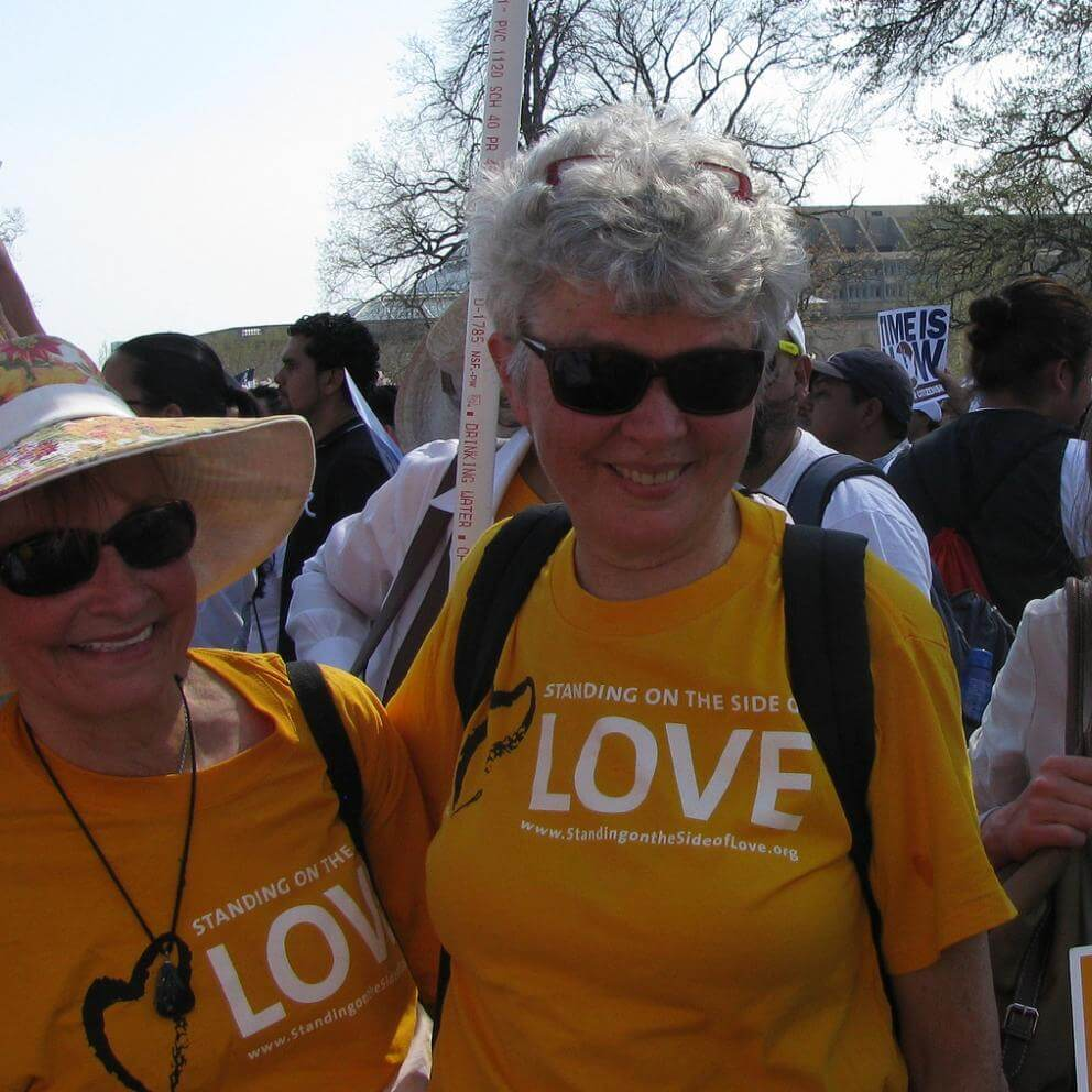 two women wear Standing on the Side of Love shirts