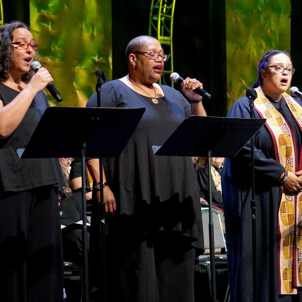 "LeLaina Romero, Amanda Thomas, and the Rev. Sofía Betancourt sing ""For You I Sing,"" by Margaret Nes, during the Service of the Living Tradition."