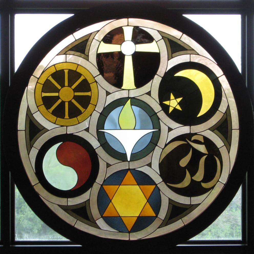 Rehnberg Window UU Church Rockford Ill. Stained Glass window showing symbols of world religions, and a flaming chalice.