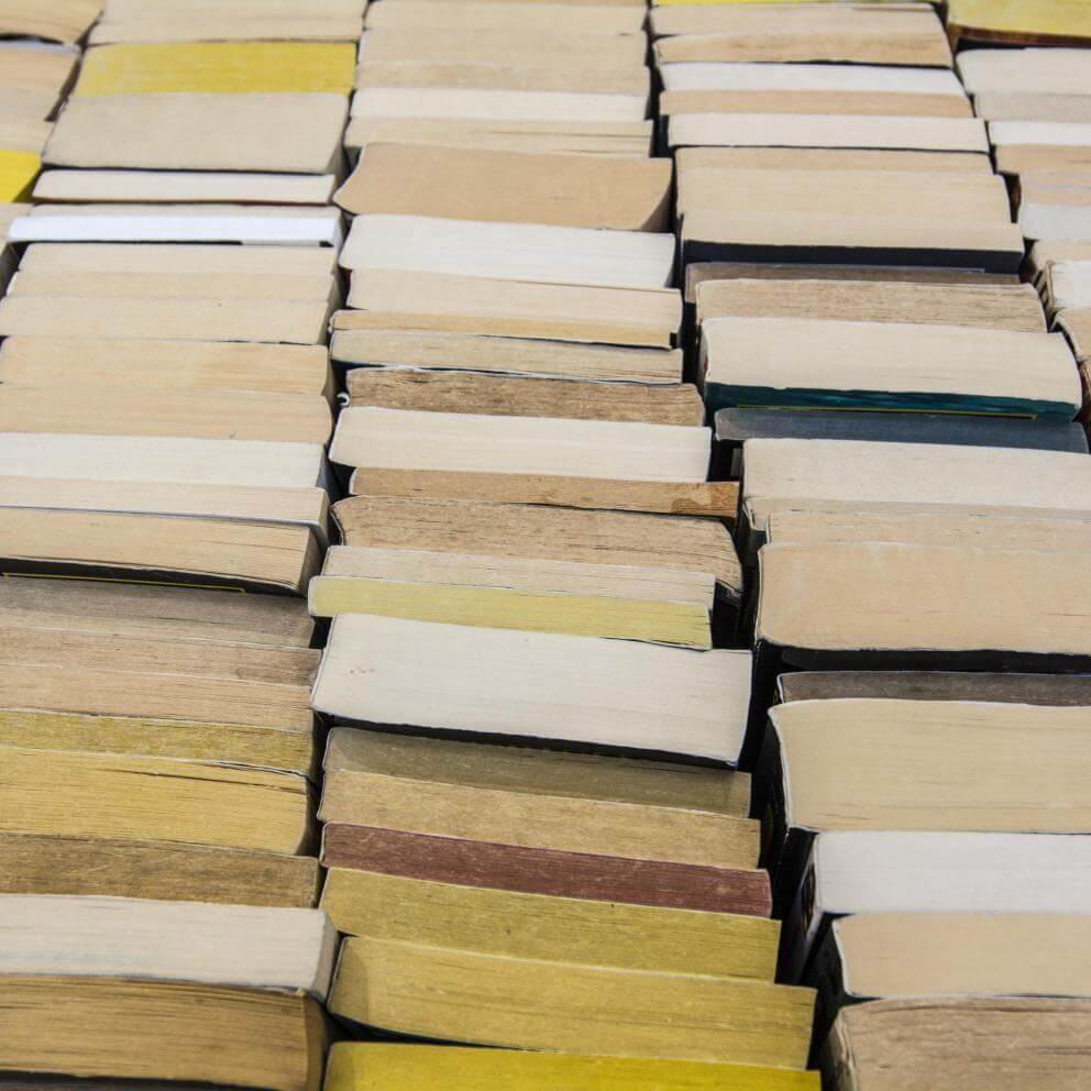Stock photo of stacks of books on a bookshelf.
