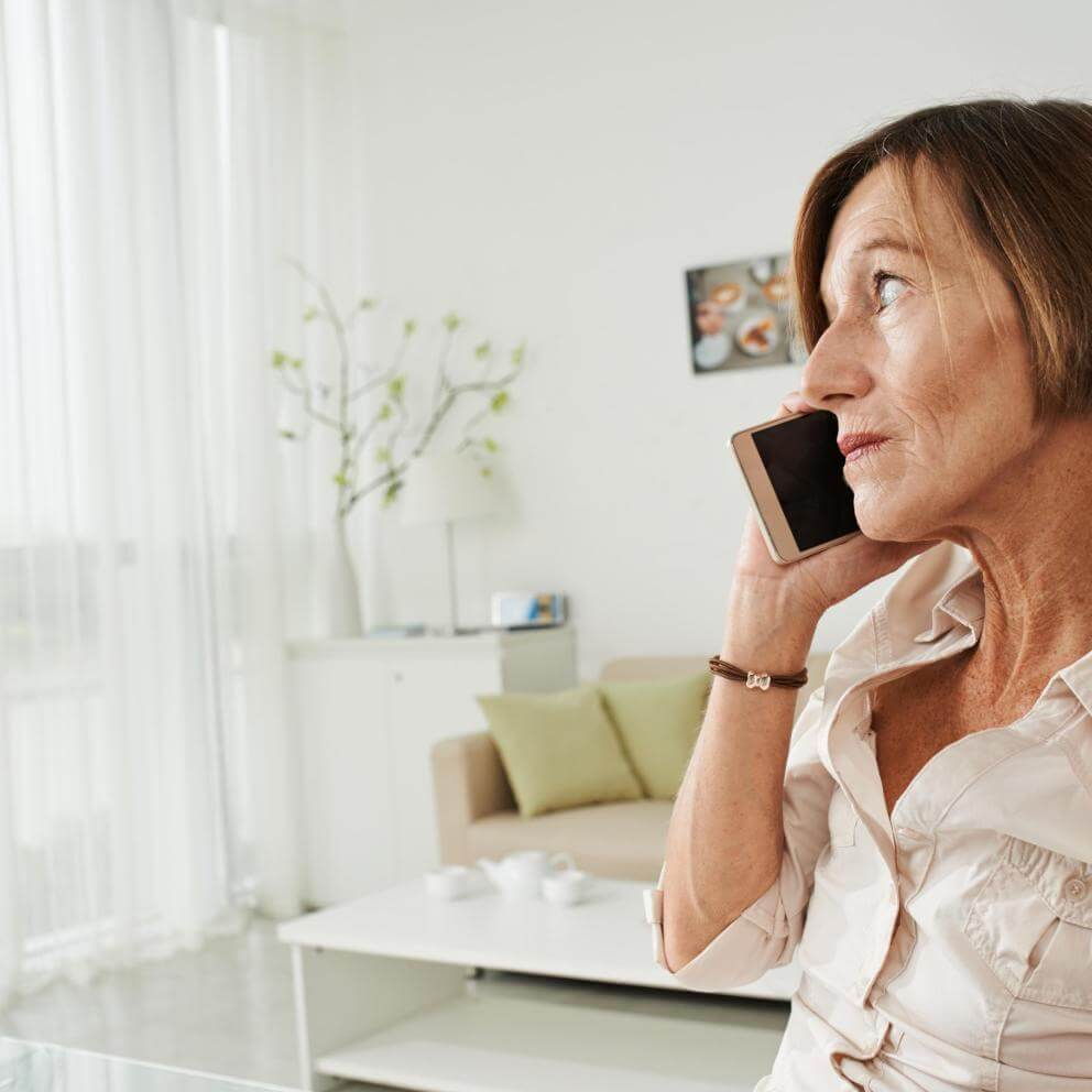 Stock photo of an older woman on the phone