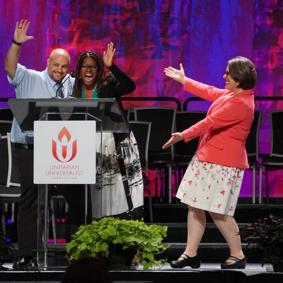 From right: UUA President Susan Frederick-Gray presents Co-Moderators Elandria Williams and Mr. Barb Greve during the General Assembly Opening Celebration in 2019.
