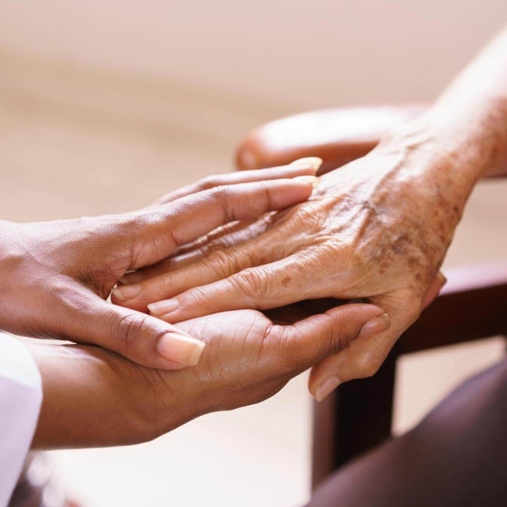 Senior Woman Talking With Black Doctor In Hospice - Stock image