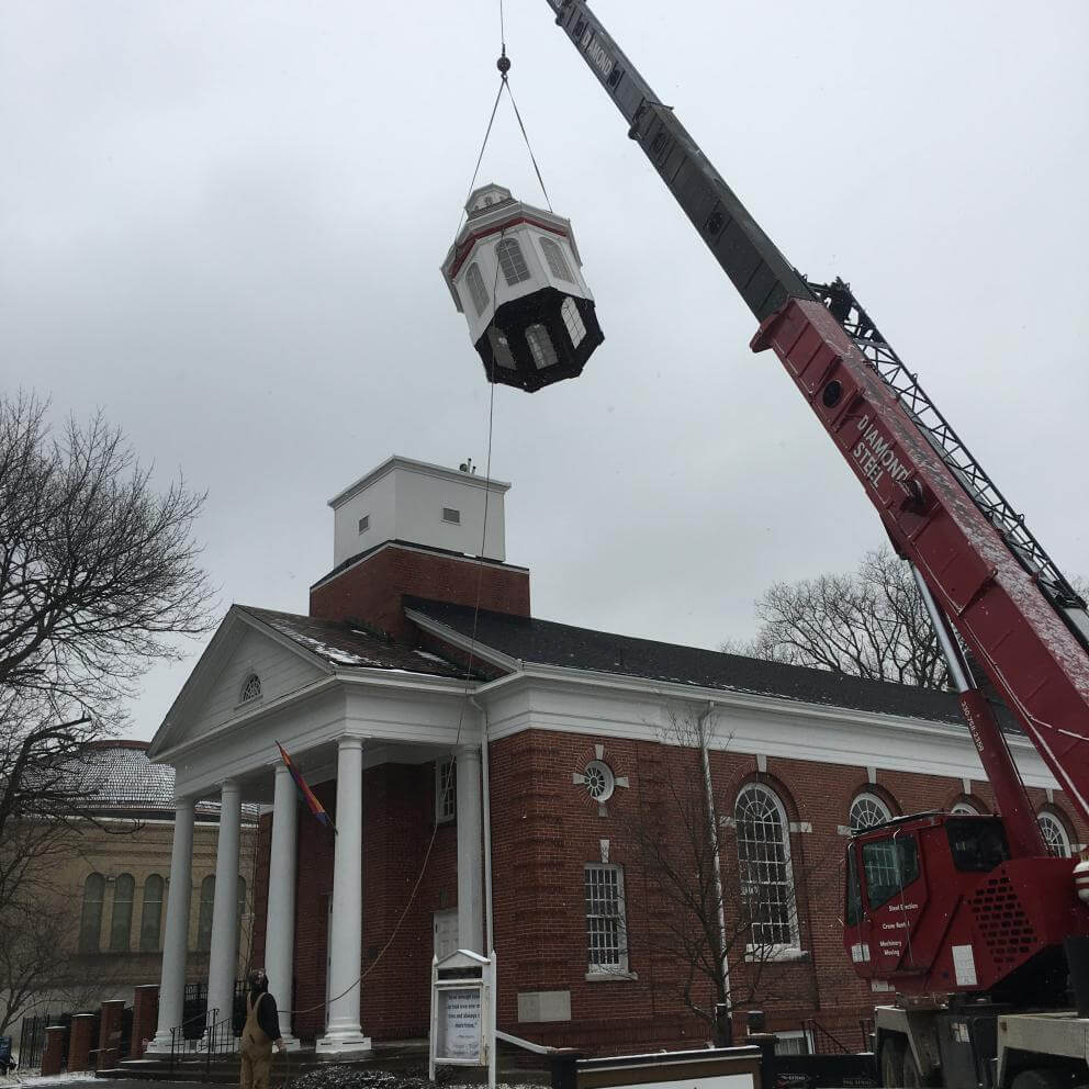 A cupola is installed on First UU Church of Youngstown, Ohio.