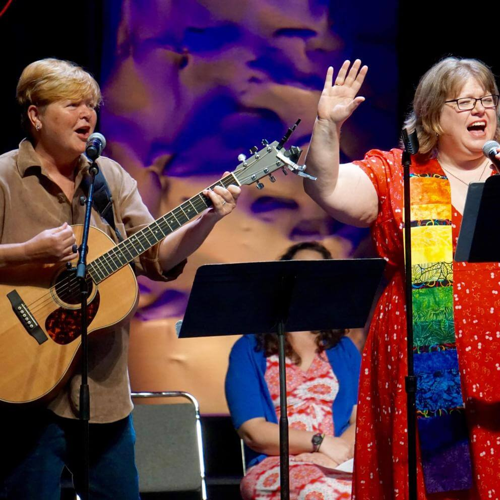 "Kiya Heartwood and the Rev. Kimberley Debus perform their new song, ""Are All Called""—the theme of GA 2018—during the Opening Celebration's worship service."